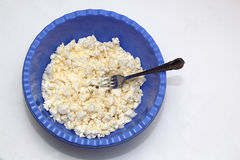Quark dough with a fork. In a bowl Stock Images