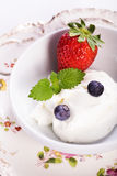 Quark with strawberries Royalty Free Stock Images