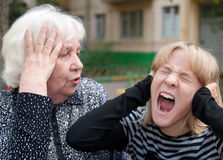 Quarrel. The grandmother and the grand daughter: quarrel Royalty Free Stock Photos