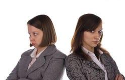 Quarrel. Two пirls in suits quarrel Royalty Free Stock Image