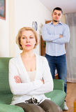 Quarrel of adult son and senior mother. Conflict between adult son and aged mother at home Stock Photo