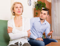 Quarrel of adult son and senior mother. Domestic quarrel between adult son and senior mature mother Royalty Free Stock Images