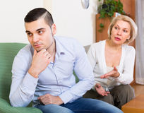 Quarrel of adult son and senior mother. Domestic quarrel between adult son and senior mature mother at home Stock Images