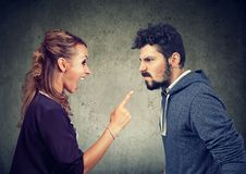 Quarrel between angry man and frustrated woman stock photos