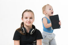 Quarrel brother and sister. Girl takes away the boy melenko tablet Royalty Free Stock Photography