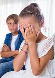 Quarrel between brother and small sister Stock Photos