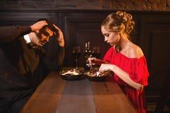 Quarrel of couple in restaurant, bad evening Royalty Free Stock Photos