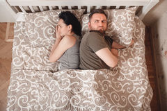 Quarrel couple trying to sleep Royalty Free Stock Photography