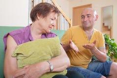 Quarrel between an elderly mother and  son. Quarrel between an elderly mother and adult son Stock Photos