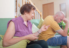 Quarrel between an elderly mother and  son. Stock Photography