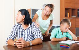 Quarrel of family. Family of three with teenager son having quarrel at home royalty free stock photography