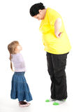Quarrel fat mother and daughter Stock Image