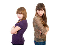 Quarrel girls isolated. Over white background Royalty Free Stock Photography