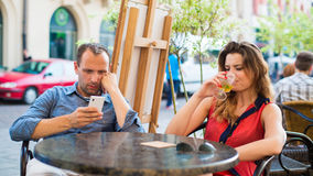 Quarrel man and woman couple in cafe. Close-up. Stock Image