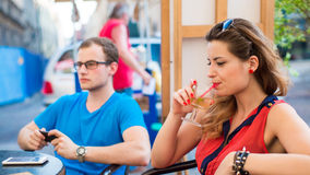 Quarrel man and woman couple in cafe. Stock Photography