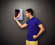 Quarrel between man and woman. Quarrel between the men and the women over dark background Royalty Free Stock Images