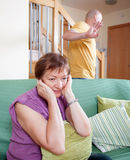 Quarrel between  mother and  son. Quarrel between an elderly mother and adult son Royalty Free Stock Photo