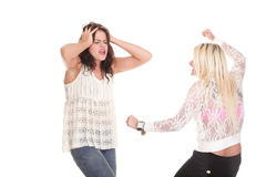Quarrel, screaming between two young women Stock Photos