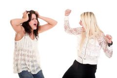 Quarrel, screaming between two young women Stock Photography