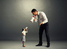 Quarrel between small woman and big man Royalty Free Stock Photography