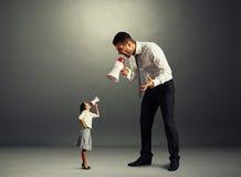 Quarrel between small woman and big man Royalty Free Stock Photography