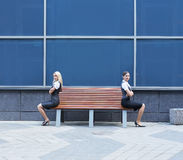 A quarrel between two businesswomen on the bench Stock Image