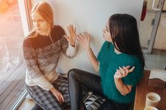 Quarrel two friends. Two women screaming at each other.  Royalty Free Stock Images
