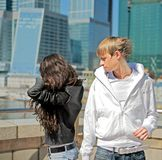 The quarrel between the two stylish teenagers Royalty Free Stock Photo