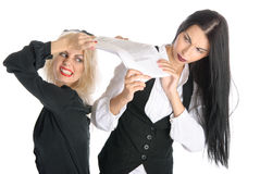 Quarrel of two women because papers. Isolated in white Royalty Free Stock Photography