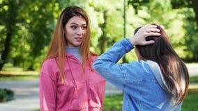 Quarrel between two young women in the park, girlfriends conflict stock video