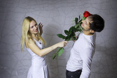 Quarrel. Young loving couple and flowers Stock Image