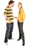 A quarrel between young man and woman. Isolated on white Stock Photography