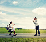 Quarrel between young man and woman Royalty Free Stock Photography
