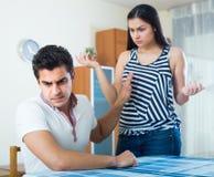 Quarrel between young spouses at home Stock Photos
