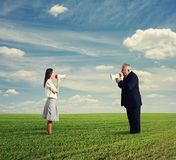 Quarrel between young woman and senior man Royalty Free Stock Images
