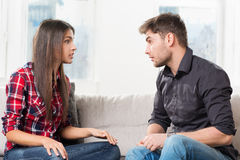 Quarreled couple in their living room Stock Images