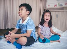 Quarreling conflict of children. Relationship difficulties in fa. Quarreling conflict of children. Asian girl has problem between brother and scream crying with royalty free stock photo