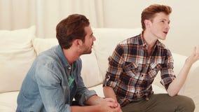 Quarreling between homosexual couple. In the living room stock video