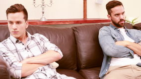 Quarreling between homosexual couple. In the living room stock video footage
