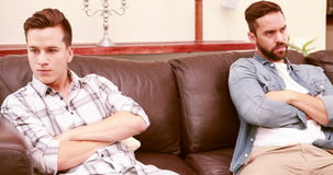 Quarreling between homosexual couple. In the living room stock footage