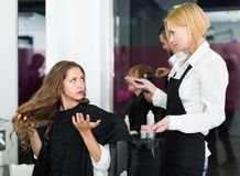 Quarrels with the female client about haircut Stock Images