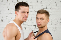 Quarrels. Love and relationships. Two guys. Two beautiful guys. Love and relationships. Passion and hatred. Studio. Backgrounds royalty free stock photo