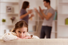 Quarrels upset child. Ð¡hild suffering from quarrels between parents in the family at home stock images