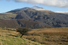 Quarried mountain. Mountain showing the historical site of industrial slate quarrying and mining Stock Image