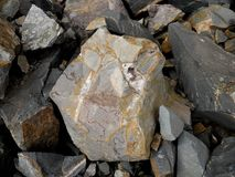 Quarried Rocks. Basalt containing crystals and Calcite stock photography