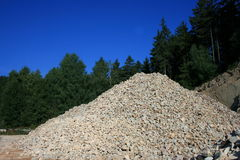 In the quarry. A pile of gravel in a quarry on the edge Stock Photography