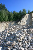 In the quarry. A pile of gravel in a quarry on the edge Stock Image