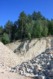 In the quarry. A pile of gravel in a quarry on the edge Royalty Free Stock Photo