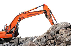 Quarry. Machine scooping up big granite rocks in quarry, isolated on white stock photography
