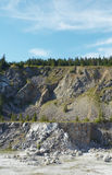Quarry. Marble quarry with blue sky and trees Royalty Free Stock Image